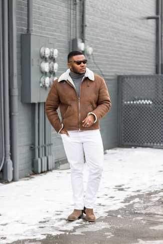 How to wear: brown suede chelsea boots, white chinos, grey turtleneck, brown shearling jacket