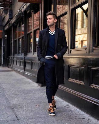 How to wear: black leather low top sneakers, navy chinos, navy and white v-neck sweater, black overcoat