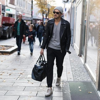 How to wear: grey leather low top sneakers, black chinos, grey v-neck t-shirt, black leather biker jacket