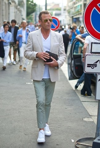 How to wear: white leather low top sneakers, mint chinos, white v-neck t-shirt, beige blazer