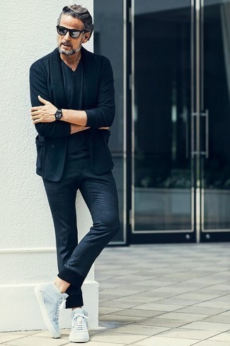 How to Wear a Navy Blazer For Men: This combination of a navy blazer and navy chinos looks amazing, but it's also super easy to wear. Light blue canvas high top sneakers will bring a sense of stylish casualness to an otherwise mostly classic look.