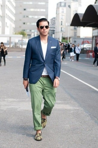 How to Wear a White V-neck T-shirt For Men: To put together a relaxed casual ensemble with a twist, dress in a white v-neck t-shirt and green chinos. If you feel like stepping it up, complement this look with olive camouflage canvas loafers.