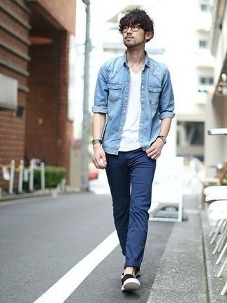 How to Wear a Light Blue Denim Shirt For Men: A light blue denim shirt and navy chinos are absolute menswear staples that will integrate wonderfully within your day-to-day collection. For extra fashion points, introduce a pair of black canvas slip-on sneakers to this look.
