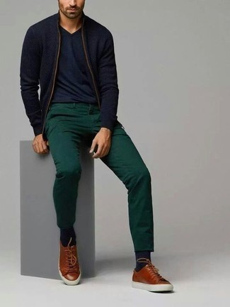 Men's Looks & Outfits: What To Wear In 2020: This pairing of a navy zip sweater and dark green chinos is very easy to put together and so comfortable to rock from dawn till dusk as well! A pair of brown leather low top sneakers will bring a fun feel to this look.
