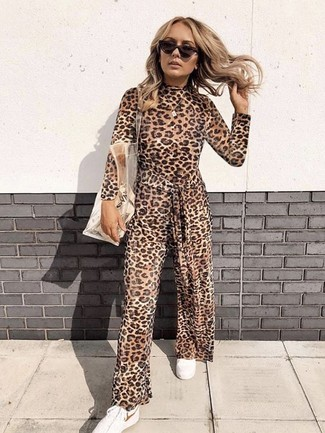 How to wear: dark brown sunglasses, clear rubber tote bag, white low top sneakers, brown leopard jumpsuit