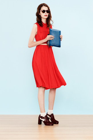 How to wear: beige leather belt, blue studded leather clutch, burgundy leather ankle boots, red midi dress