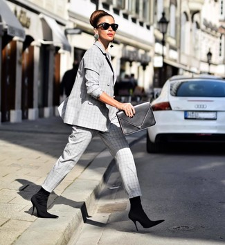 How to wear: black sunglasses, black leather clutch, black elastic ankle boots, grey plaid suit