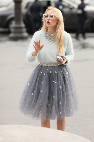 How to Wear a Grey Full Skirt: This pairing of a white fluffy crew-neck sweater and a grey full skirt will prove your styling prowess even on off-duty days.
