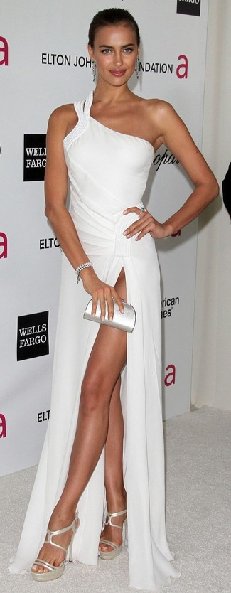 How to wear: silver bracelet, silver leather clutch, silver leather heeled sandals, white evening dress