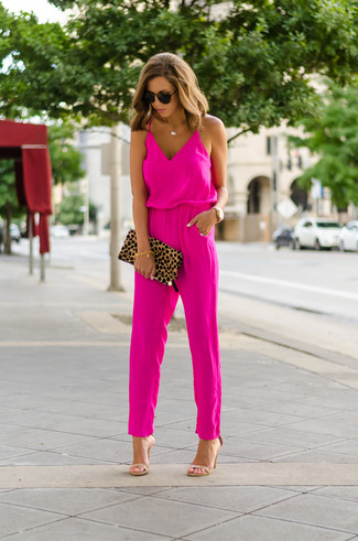 How to wear: dark brown sunglasses, tan leopard suede clutch, tan leather heeled sandals, hot pink jumpsuit