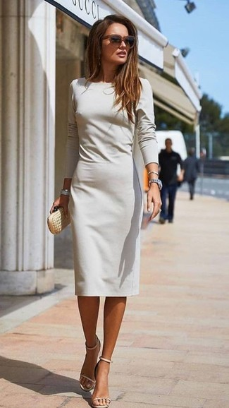 How to wear: dark brown sunglasses, gold leather clutch, beige leather heeled sandals, grey sheath dress