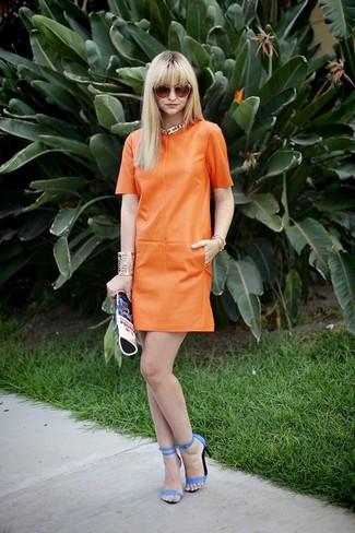 How to wear: orange sunglasses, blue print leather clutch, blue leather heeled sandals, orange leather shift dress