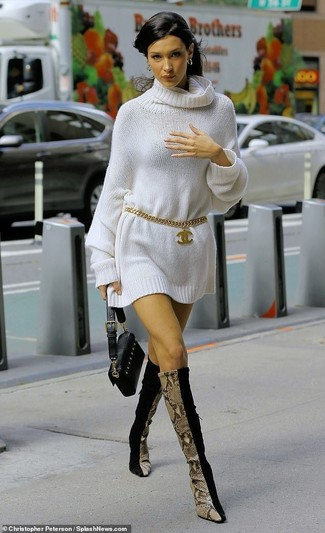 How to wear: gold belt, black leather clutch, black suede knee high boots, white sweater dress