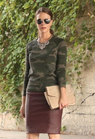 How to wear: black sunglasses, beige suede clutch, burgundy leather pencil skirt, olive camouflage crew-neck sweater