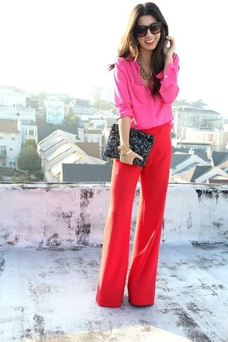 How to wear: black sunglasses, black sequin clutch, red wide leg pants, hot pink dress shirt