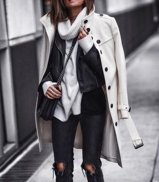 How to wear: white coat, black leather biker jacket, white cowl-neck sweater, black ripped skinny jeans