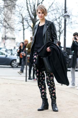 How to wear: black coat, black leather biker jacket, black crew-neck sweater, black floral sweatpants