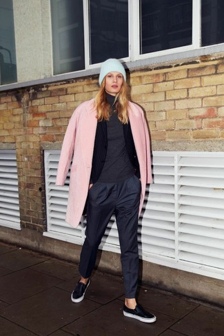 A pink coat and navy slacks couldn't possibly come across as other than strikingly elegant. For footwear go down the casual route with black leather slip-on sneakers.