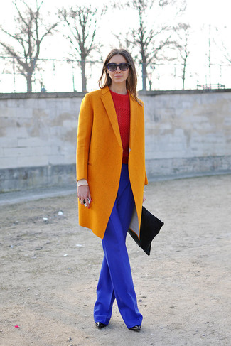 How to wear: orange coat, red cable sweater, blue wide leg pants, black leather ankle boots