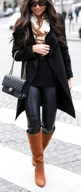 How to wear: black coat, black crew-neck sweater, black leather leggings, tobacco leather knee high boots