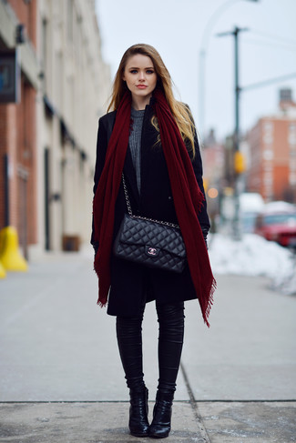 How to wear: black coat, charcoal crew-neck sweater, black skinny jeans, black leather ankle boots