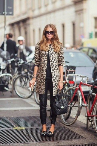 How to wear: camel leopard coat, black crew-neck sweater, black leather skinny jeans, black leather loafers