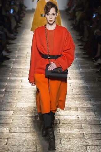 How to wear: orange coat, orange crew-neck sweater, black skinny pants, black leather ankle boots