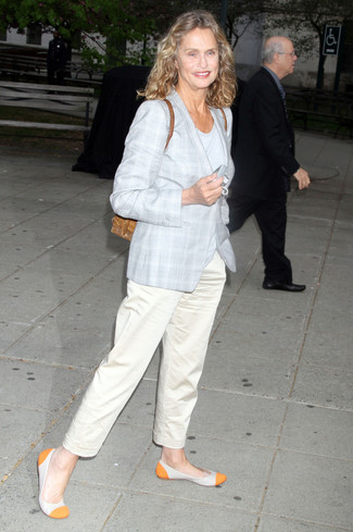 Lauren Hutton wearing Grey Plaid Coat, Grey Crew-neck T-shirt, Beige Chinos, Orange Leather Ballerina Shoes
