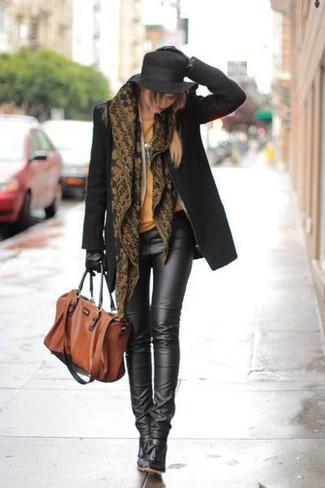 How to wear: black coat, orange crew-neck t-shirt, black leather leggings, black leather ankle boots