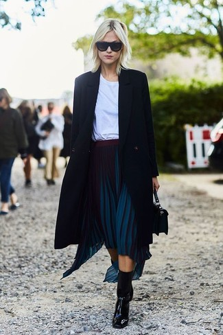 How to wear: black coat, white crew-neck t-shirt, navy pleated midi skirt, black leather ankle boots