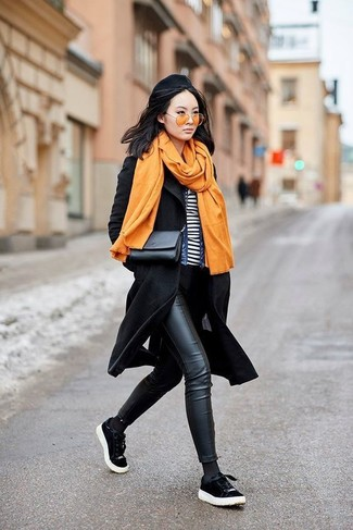 For a casual chic getup, reach for a black coat and Oliver Peoples Deep Amber Sunglasses — these items fit really well together. Make black suede low top sneakers your footwear choice to have some fun with things. We love how this getup gets you excited for autumn in no time.