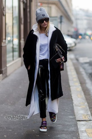 Try teaming a black coat with a grey beanie if you're going for a neat, stylish look. For something more on the daring side to complement this getup, throw in a pair of black embellished low top sneakers. We love how this getup gets you excited for colder weather in no time.