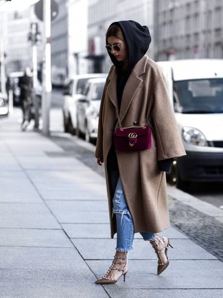 How to wear: camel coat, black hoodie, blue ripped jeans, brown studded leather pumps