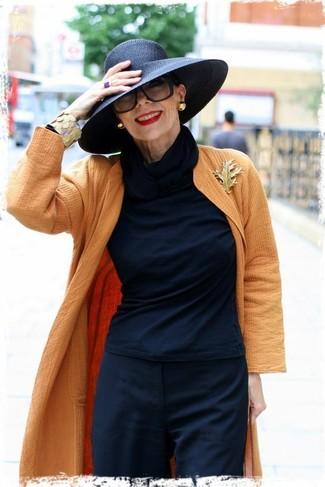 How to wear: orange coat, black long sleeve t-shirt, black dress pants, black hat