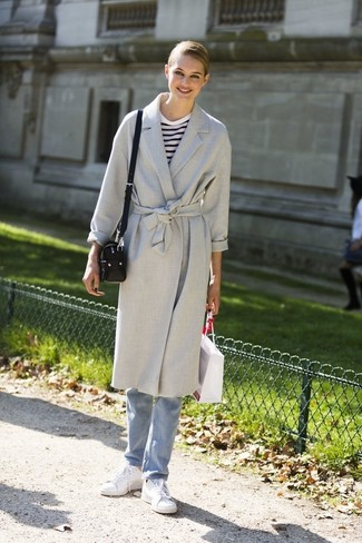 How to wear: grey coat, white and navy horizontal striped long sleeve t-shirt, light blue jeans, white leather low top sneakers
