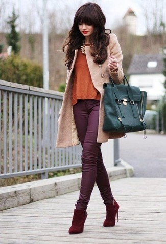 Wear a camel coat with jewelry to achieve a neat and proper look. Finish off with red suede ankle boots and off you go looking stunning. We love how this look brings you into fall mode in no time.