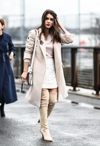 A nude long sleeve t-shirt and a white lace mini skirt are perfect for both running errands and a night out. This outfit is complemented perfectly with cream suede over the knee boots.
