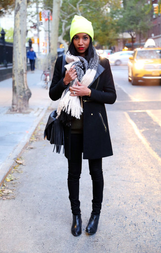 How to wear: black coat, olive oversized sweater, black skinny jeans, black leather ankle boots