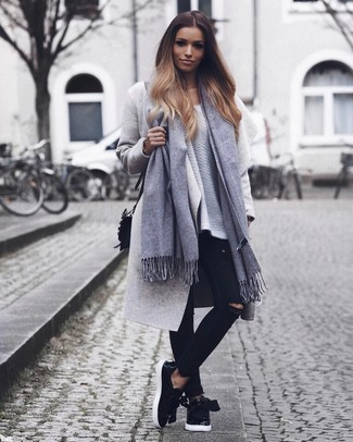 Choose a grey coat and black ripped skinny jeans and you'll look like a total babe. Dress down this ensemble with black leather slip-on sneakers. Loving how this getup gets you excited for chillier weather in next to no time.