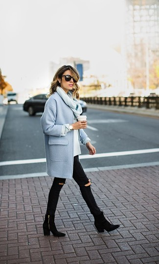 A baby blue coat and black destroyed slim jeans are a great outfit formula to have in your arsenal. For the maximum chicness opt for a pair of black suede booties.