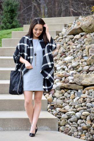 How to wear: black plaid coat, grey shift dress, black leather pumps, black leather tote bag