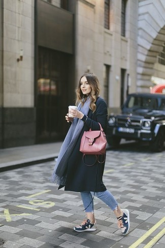 How to wear: black coat, light blue skinny jeans, navy athletic shoes, red leather satchel bag