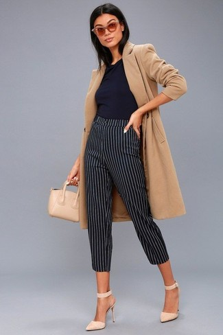 Perfect the smart casual look in a camel coat and Ralph Lauren Cat Eye Spectator Sunglasses. Round off this outfit with beige suede pumps. This ensemble is everything for when leaves are falling down and autumn is setting in.