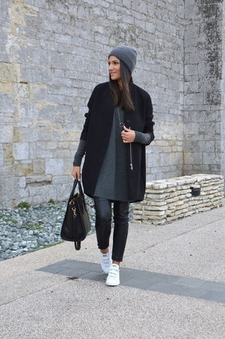 How to wear: black coat, grey sweater dress, black leather skinny jeans, white leather low top sneakers