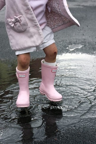 How to wear: pink coat, pink sweater, white shorts, pink rain boots