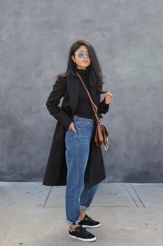 A smart casual pairing of a black coat and grey sunglasses can maintain its relevance in many different circumstances. Take your look into a more casual direction with black low top sneakers. This look is the definition of perfect for when leaves turn yellow and red and fall is at its best.
