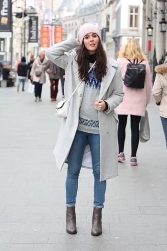 How to wear: grey coat, black turtleneck, grey fair isle crew-neck sweater, blue skinny jeans