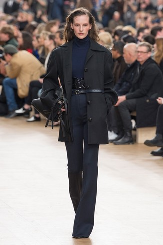How to wear: black coat, navy turtleneck, navy flare pants, black leather ankle boots
