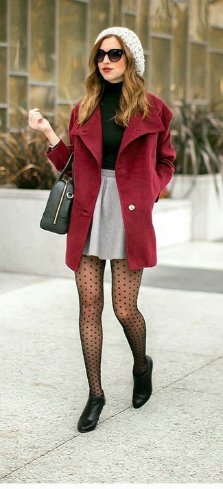 An oxblood coat and a grey pleated skirt is a smart combination to add to your styling repertoire. A pair of black leather ankle boots adds some real flair to this ensemble. This outfit is a nice option when spring arrives.