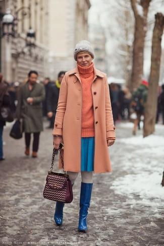 How to wear: orange coat, orange knit turtleneck, blue skater skirt, blue leather knee high boots